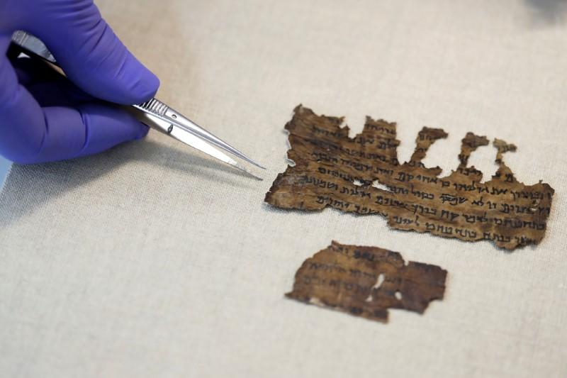 Fragments from the Dead Sea Scrolls that underwent genetic sampling to shed light on the 2,000-year-old biblical trove are shown to Reuters at the Israel Antiquities Authority laboratory in Jerusalem
