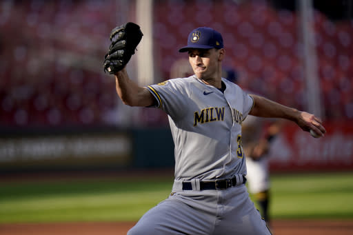 Milwaukee Brewers starting pitcher Brent Suter throws during the second inning in the first game of a baseball doubleheader against the St. Louis Cardinals Friday, Sept. 25, 2020, in St. Louis. (AP Photo/Jeff Roberson)