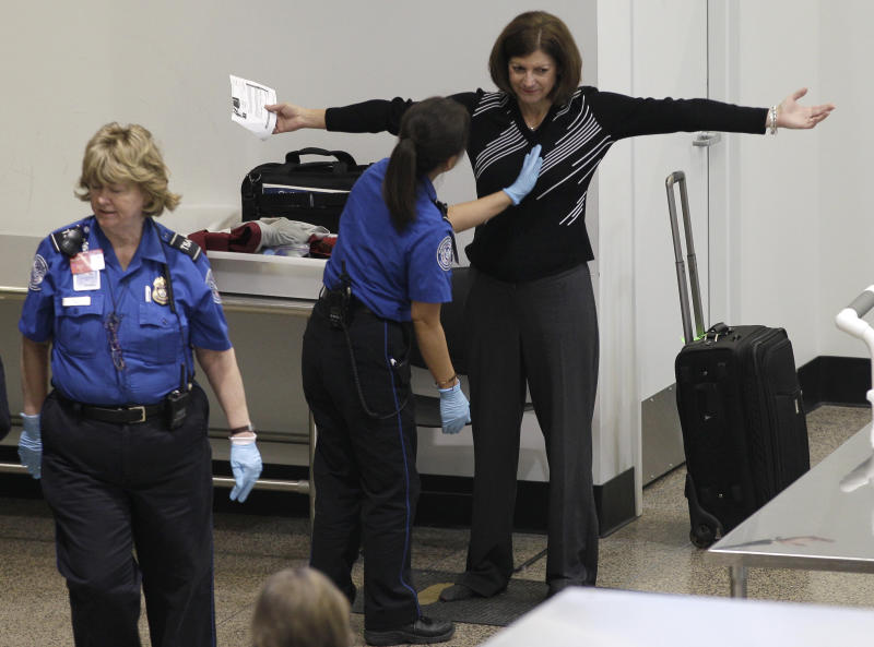A woman undergoes a pat-down during security screening, Friday, Nov. 19, 2010, at Seattle-Tacoma International Airport in Seattle. (AP Photo/Ted S. Warren)