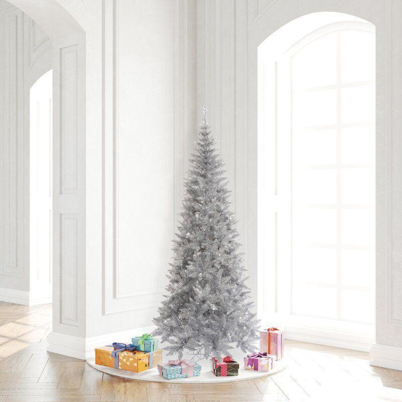 """<p><strong>The Holiday Aisle</strong></p><p>wayfair.com</p><p><strong>$209.90</strong></p><p><a href=""""https://go.redirectingat.com?id=74968X1596630&url=https%3A%2F%2Fwww.wayfair.com%2Fholiday-decor%2Fpdp%2Fthe-holiday-aisle-65-silver-tinsel-fir-artificial-christmas-tree-w003133902.html&sref=https%3A%2F%2Fwww.housebeautiful.com%2Fentertaining%2Fholidays-celebrations%2Fg4010%2Fbest-artificial-christmas-trees%2F"""" rel=""""nofollow noopener"""" target=""""_blank"""" data-ylk=""""slk:BUY NOW"""" class=""""link rapid-noclick-resp"""">BUY NOW</a></p><p>If a little extra sparkle is what you seek, skip the white tree and go for its metallic cousin: the silver tinsel tree. It won't look like the real thing, but it's absolutely stunning when all lit up.</p>"""