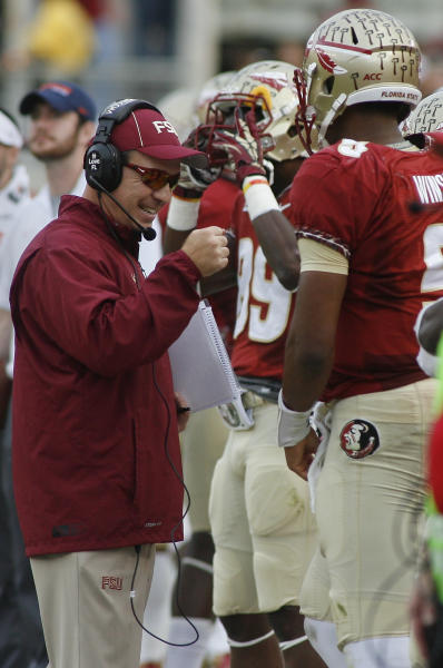 Florida State head coach Jimbo Fisher celebrates a touchdown with quarterback Jameis Winston (5) in the first quarter of an NCAA college football game on Saturday, Nov. 16, 2013, in Tallahassee, Fla. (AP Photo/Phil Sears)