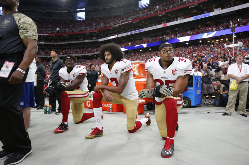 Eric Reid, Colin Kaepernick and Eli Harold took a knee in 2016. (Photo by Michael Zagaris/San Francisco 49ers/Getty Images)