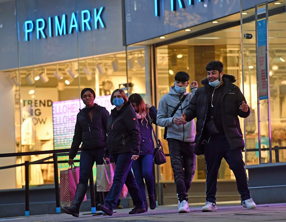 Shoppers leaving Primark in Birmingham as non-essential shops in England open their doors to customers for the first time after the second national lockdown ends and England has a strengthened tiered system of regional coronavirus restrictions.