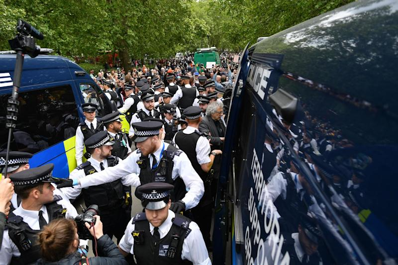There was a large police presence as Piers Corbyn was led away in handcuffs (AFP via Getty Images)