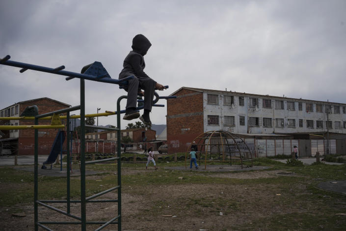 A child plays in a playground in Cape Flats, and area in Cape Town, South Africa, notorious for its gang wars and high numbers of child murders, on Sept. 11, 2020. (AP Photo/Bram Janssen)