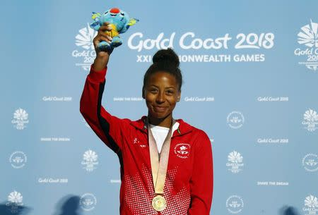 Diving - Gold Coast 2018 Commonwealth Games - Women's 3m Springboard Medal Ceremony - Optus Aquatic Centre - Gold Coast, Australia - April 14, 2018. Gold medalist Jennifer Abel of Canada on the podium. REUTERS/David Gray
