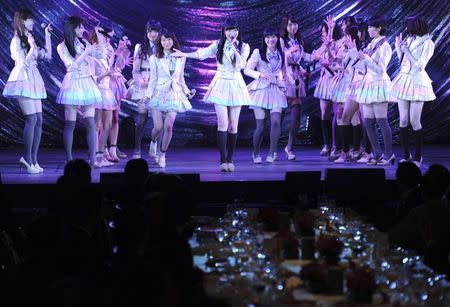 Japanese girls' pop group AKB48, led by Rino Sashihara (C), performs on the stage during a gala dinner of the ASEAN-Japan Commemorative Summit meeting hosted by Japan's Shinzo Abe (not in picture), in Tokyo December 14, 2013 file photo. REUTERS/Toshifumi Kitamura/Pool/Files