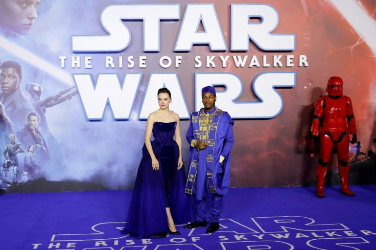 "This file photo taken on December 18, 2019 shows actors Daisy Ridley and John Boyega posing upon arrival for the European premiere in London of ""Star Wars: The Rise of Skywalker"""