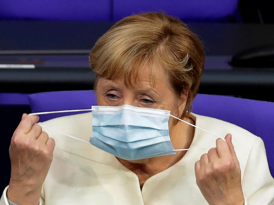 German Chancellor Angela Merkel adjust her face mask during a budget debate as part of a meeting of the German federal parliament, Bundestag, at the Reichstag building in Berlin, Germany, Tuesday, Sept. 29, 2020. (AP Photo/Michael Sohn) (Photo: ASSOCIATED PRESS)