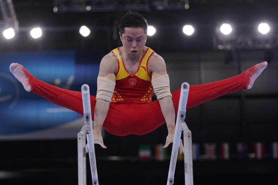 China's You Hao performs on the parallel bars during the men's artistic gymnastic qualifications at the 2020 Summer Olympics, Saturday, July 24, 2021, in Tokyo. (AP Photo/Gregory Bull)