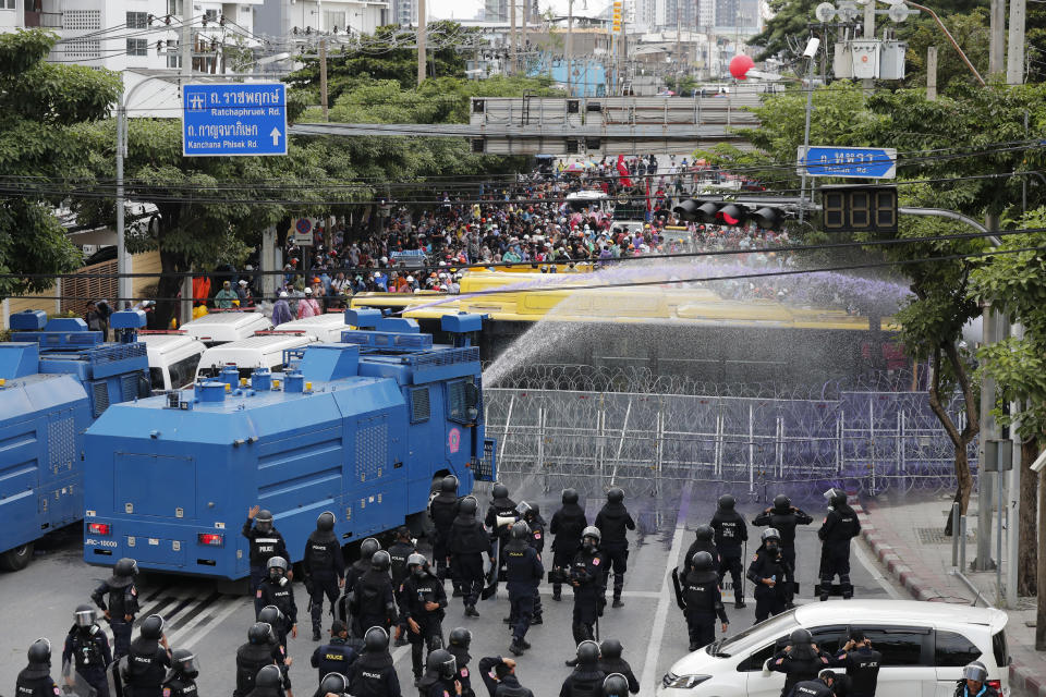Police use water cannons to disperse pro-democracy demonstrators near the Parliament in Bangkok, Tuesday, Nov. 17, 2020. Thailand's political battleground shifted to the country's Parliament Tuesday, where lawmakers are considering proposals to amend the country's constitution, one of the core demands of the student-led pro-democracy movement. (AP Photo/Sakchai Lalit)