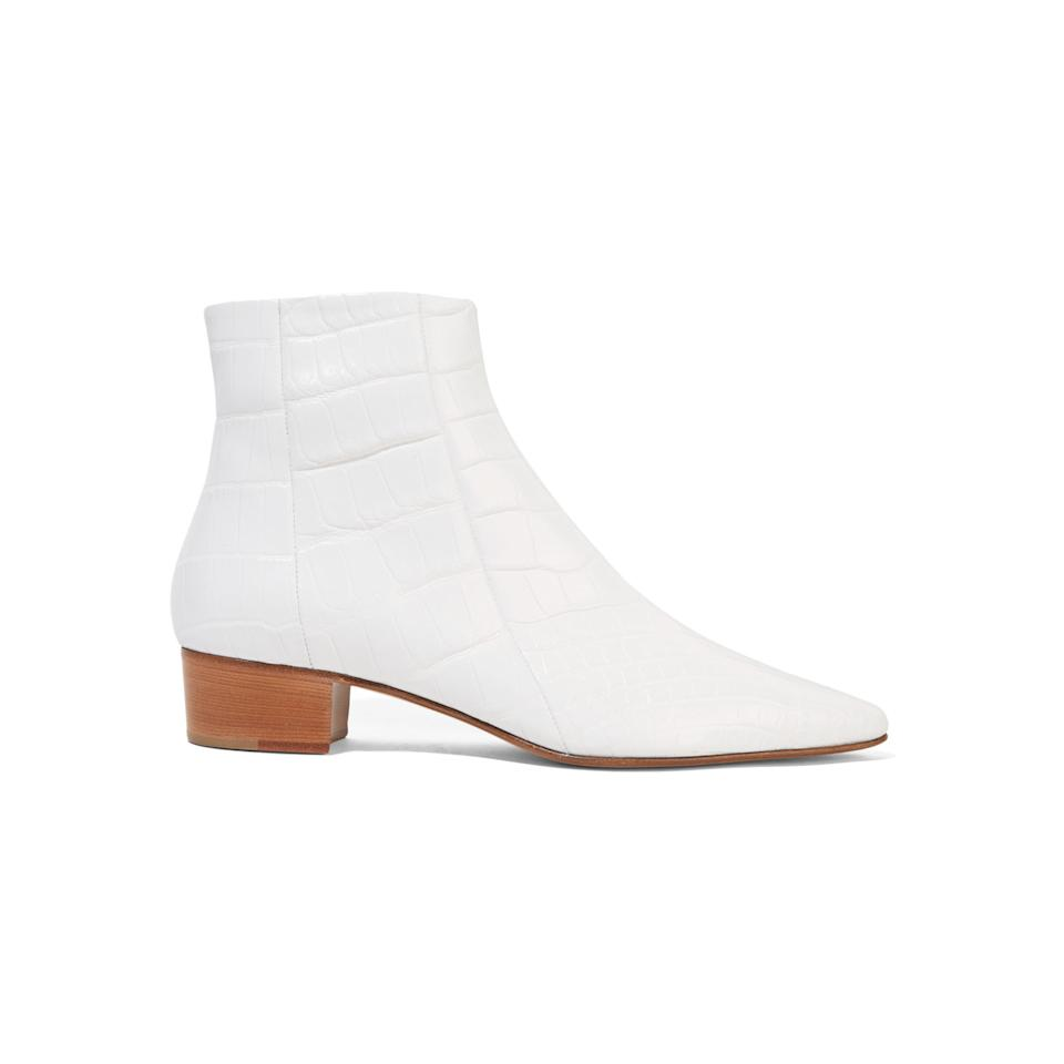 """<p>The Row boots, $7,500, <a rel=""""nofollow"""" href=""""https://www.net-a-porter.com/us/en/product/709762/the_row/ambra-glossed-alligator-ankle-boots?mbid=synd_yahoolife"""">net-a-porter.com</a></p>"""