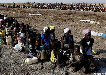 Women and children wait to be registered prior to a food distribution carried out by the United Nations World Food Programme (WFP) in Thonyor, Leer state