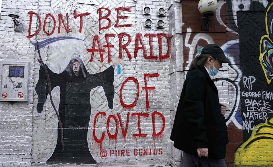 """Mural in New York City on Oct. 20, 2020, depicting President Donald Trump by an artist who goes by the name """"Pure Genius."""" On Oct. 5, 2020, the president tweeted that he was leaving the Walter Reed National Military Medical Center after being treated for COVID-19: """"Feeling really good! Don't be afraid of Covid. Don't let it dominate your life."""""""