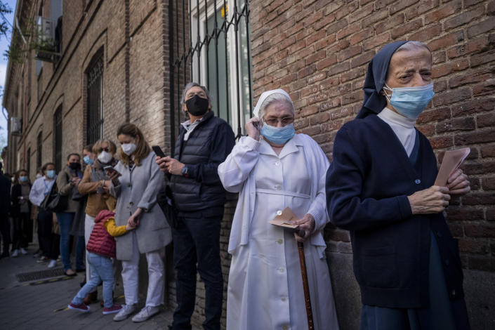 People queue to cast their votes during the regional election in Madrid, Spain, Tuesday, May 4, 2021. Over 5 million Madrid residents are voting for a new regional assembly in an election that tests the depths of resistance to lockdown measures and the divide between left and right-wing parties. (AP Photo/Bernat Armangue)