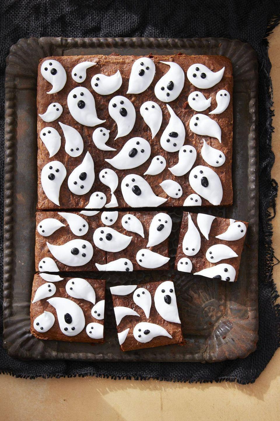 """<p>Kids will love piping the friendly marshmallow ghosts on top of these brownies. </p><p><em><a href=""""https://www.countryliving.com/food-drinks/a28943165/marshmallow-ghost-brownies-recipe/"""" rel=""""nofollow noopener"""" target=""""_blank"""" data-ylk=""""slk:Get the recipe from Country Living »"""" class=""""link rapid-noclick-resp"""">Get the recipe from Country Living »</a></em></p>"""