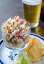 """<p>This traditional Mexican side dish is as simple to make as it is tasty. Use a can of hearts of palm to mimic the light and citrusy flavor of seafood in traditional ceviche, and add extra nutrients and crunch with plum tomatoes, red onion, habanero and lime. </p><p><a class=""""link rapid-noclick-resp"""" href=""""https://dorastable.com/habanero-hearts-of-palm-ceviche/"""" rel=""""nofollow noopener"""" target=""""_blank"""" data-ylk=""""slk:GET THE RECIPE"""">GET THE RECIPE</a></p><p><em>Per serving: 115 calories, 9 g fat (1 g saturated), 253 mg sodium, 7 g carbs, 2 g sugar, 2 g fiber, 2 g protein</em></p>"""