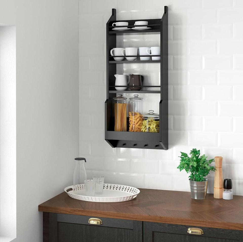 "<p>Complete with four shelves and lower hooks, the <a href=""https://www.popsugar.com/buy/Vadholma%20Wall%20Shelf-446991?p_name=Vadholma%20Wall%20Shelf&retailer=ikea.com&price=60&evar1=casa%3Aus&evar9=46151613&evar98=https%3A%2F%2Fwww.popsugar.com%2Fhome%2Fphoto-gallery%2F46151613%2Fimage%2F46152180%2FVadholma-Wall-Shelf&list1=shopping%2Cikea%2Corganization%2Ckitchens%2Chome%20shopping&prop13=api&pdata=1"" rel=""nofollow noopener"" target=""_blank"" data-ylk=""slk:Vadholma Wall Shelf"" class=""link rapid-noclick-resp"">Vadholma Wall Shelf</a> ($60) can hold plates, dishes, jars, and dish towels.</p>"