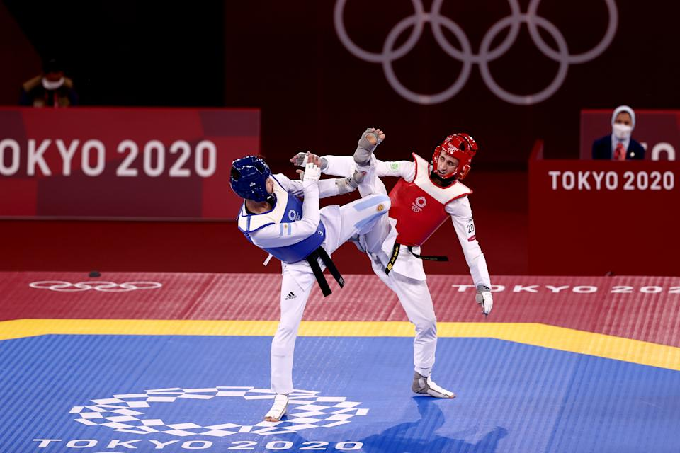 CHIBA, JAPAN - JULY 24: Lucas Lautaro Guzman (L) of Team Argentina competes against Jack Woolley of Team Ireland  during the Men's -58kg Taekwondo Round of 16 contest on day one of the Tokyo 2020 Olympic Games at Makuhari Messe Hall on July 24, 2021 in Chiba, Japan. (Photo by Maja Hitij/Getty Images
