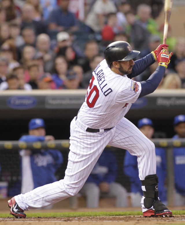 Minnesota Twins right fielder Chris Colabello (20) hits an RBI single during the first inning of a baseball game against the Kansas City Royals, Friday, April 11, 2014, in Minneapolis. Colabello was 2-3 with three RBIs on the night as Minnesota won 10-1. AP Photo/Paul Battaglia)