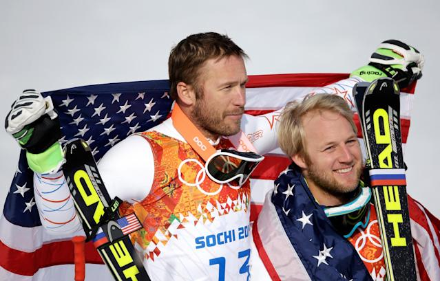 SOCHI, RUSSIA - FEBRUARY 16: Bronze medalist Bode Miller of the United States (L) and silver medalist Andrew Weibrecht of the United States celebrate during the flower ceremony for the Alpine Skiing Men's Super-G on day 9 of the Sochi 2014 Winter Olympics at Rosa Khutor Alpine Center on February 16, 2014 in Sochi, Russia. (Photo by Ezra Shaw/Getty Images)