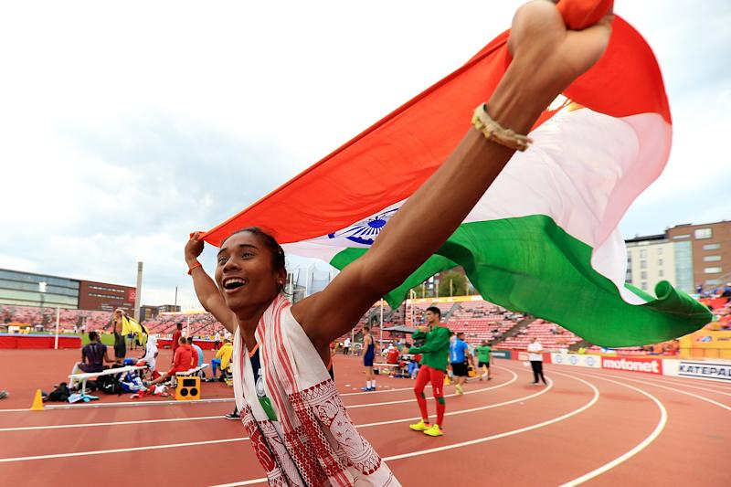 TAMPERE, FINLAND - JULY 12: Hima Das of India celebrates winning gold in the final of the women's 400m on day three of The IAAF World U20 Championships on July 12, 2018 in Tampere, Finland. (Photo by Stephen Pond/Getty Images for IAAF)