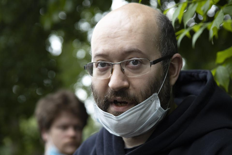 Prominent Russian journalist Ilya Azar, who was sentenced for holding a one-person protest amid lockdown, speaks to the media shortly after his release in Moscow, Russia, Sunday, June 7, 2020. A Russian journalist whose jailing prompted protests in which police detained demonstrators has been released. The detentions brought criticism that authorities were using coronavirus restrictions to suppress opposition. Ilya Azar was sentenced to 15 days in jail on May 28, but was released Sunday after a court reduced his sentence. Azar was arrested after holding a one-man picket outside police headquarters in Moscow against the jailing on extortion charges of an activist who monitors police corruption. (AP Photo/Alexander Zemlianichenko)