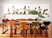 """<p>The jewel-toned, multicolored dining chairs designed by the homeowner and interior designer <a href=""""https://julianavasconcellos.com/"""" rel=""""nofollow noopener"""" target=""""_blank"""" data-ylk=""""slk:Juliana Lima Vasconcellos"""" class=""""link rapid-noclick-resp"""">Juliana Lima Vasconcellos</a> add a colorful flair to her stylish <a href=""""https://www.elledecor.com/design-decorate/house-interiors/a35808822/juliana-lima-vasconcellos-rio-apartment/"""" rel=""""nofollow noopener"""" target=""""_blank"""" data-ylk=""""slk:Rio de Janeiro dining room"""" class=""""link rapid-noclick-resp"""">Rio de Janeiro dining room</a>. </p>"""