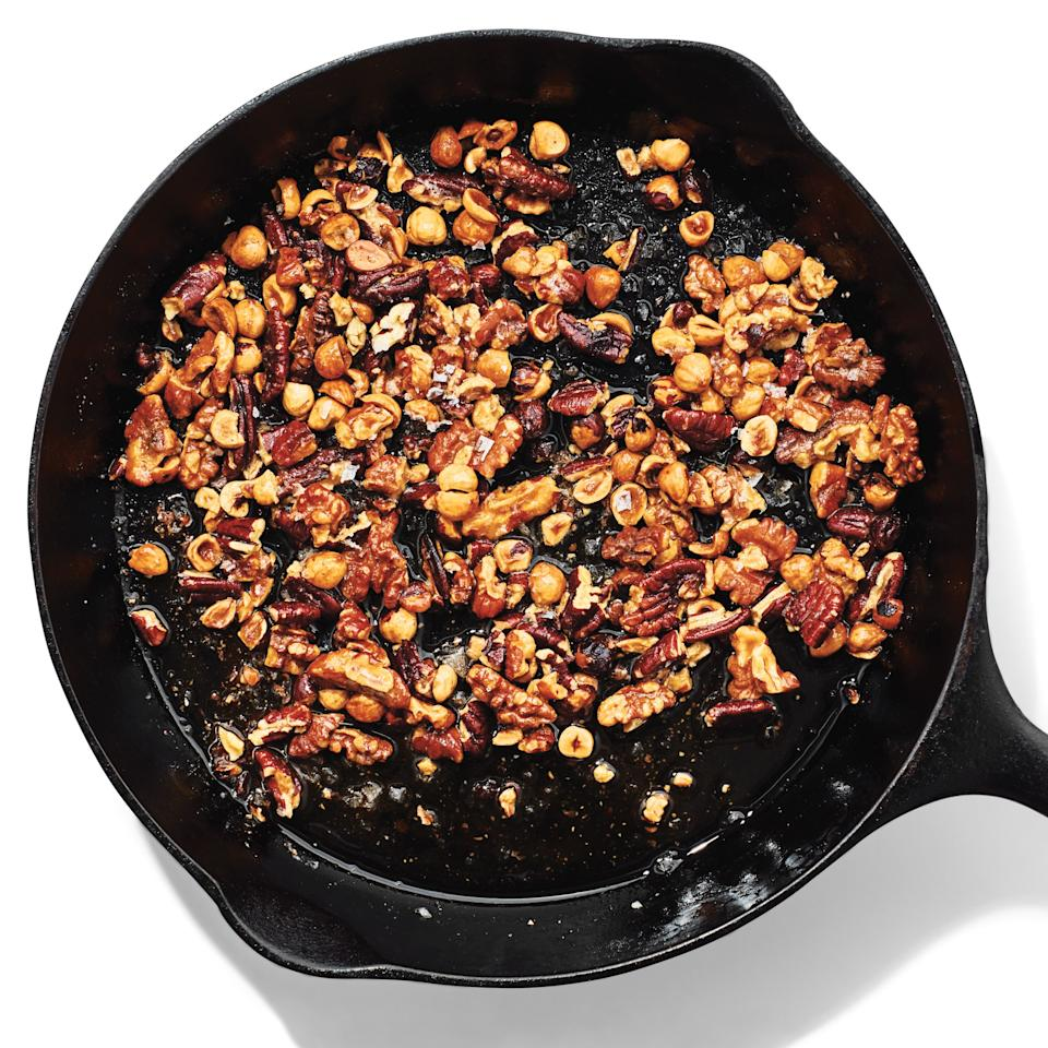 "Or, for something more indulgent and even more flavorful, cook them on the stove in butter (the fat helps distribute heat, meaning less risk of burning). Melt <strong>2 Tbsp. butter</strong> in a heavy skillet over medium heat, then add <strong>1 cup roughly chopped raw nuts</strong> and a generous sprinkle of <strong>salt</strong>. Cook, stirring frequently, for 5 to 7 minutes, until the nuts are golden. Transfer the nuts to a paper towel with a slotted spoon, let cool, then eat by the handful or sprinkle over <a href=""https://www.bonappetit.com/recipe/cod-romesco-sauce-hazelnuts-lemon-parsley?mbid=synd_yahoo_rss"">fish</a> or yogurt."