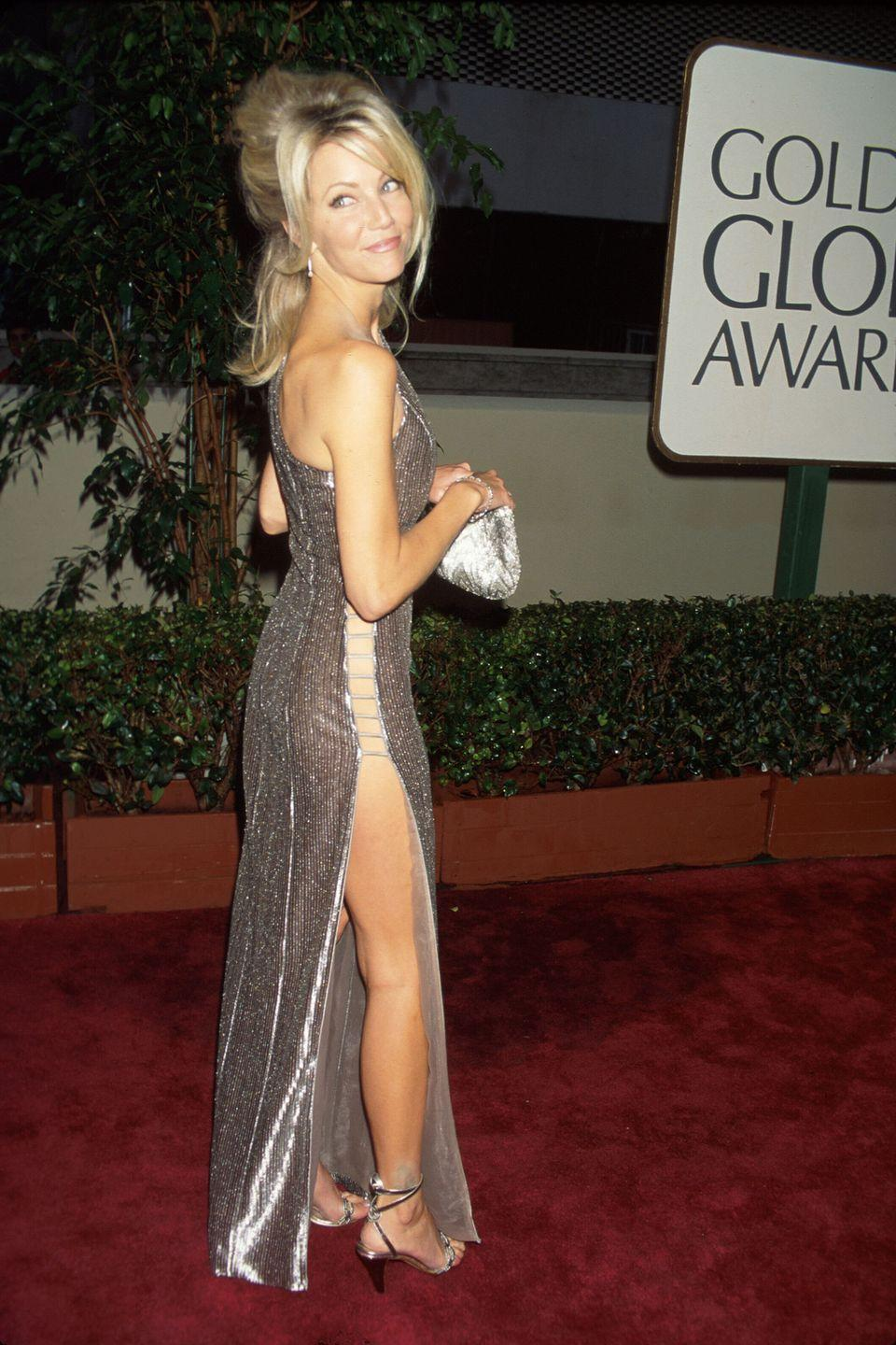 <p>The blonde bombshell was always known for her sex appeal, so it's no surprise she rocked this risqué side-split gown in 1996.</p>
