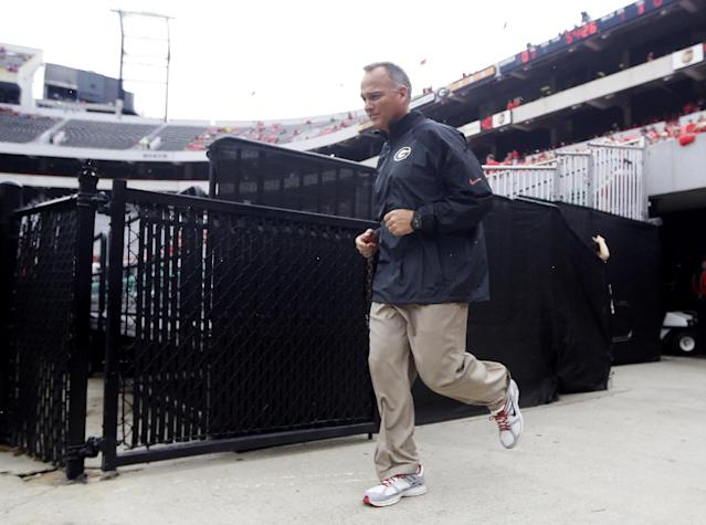 Georgia head coach Mark Richt runs out to the field as his team prepares to face North Texas in an NCAA college football game Saturday, Sept. 21, 2013 in Athens, Ga. (AP Photo/John Bazemore)