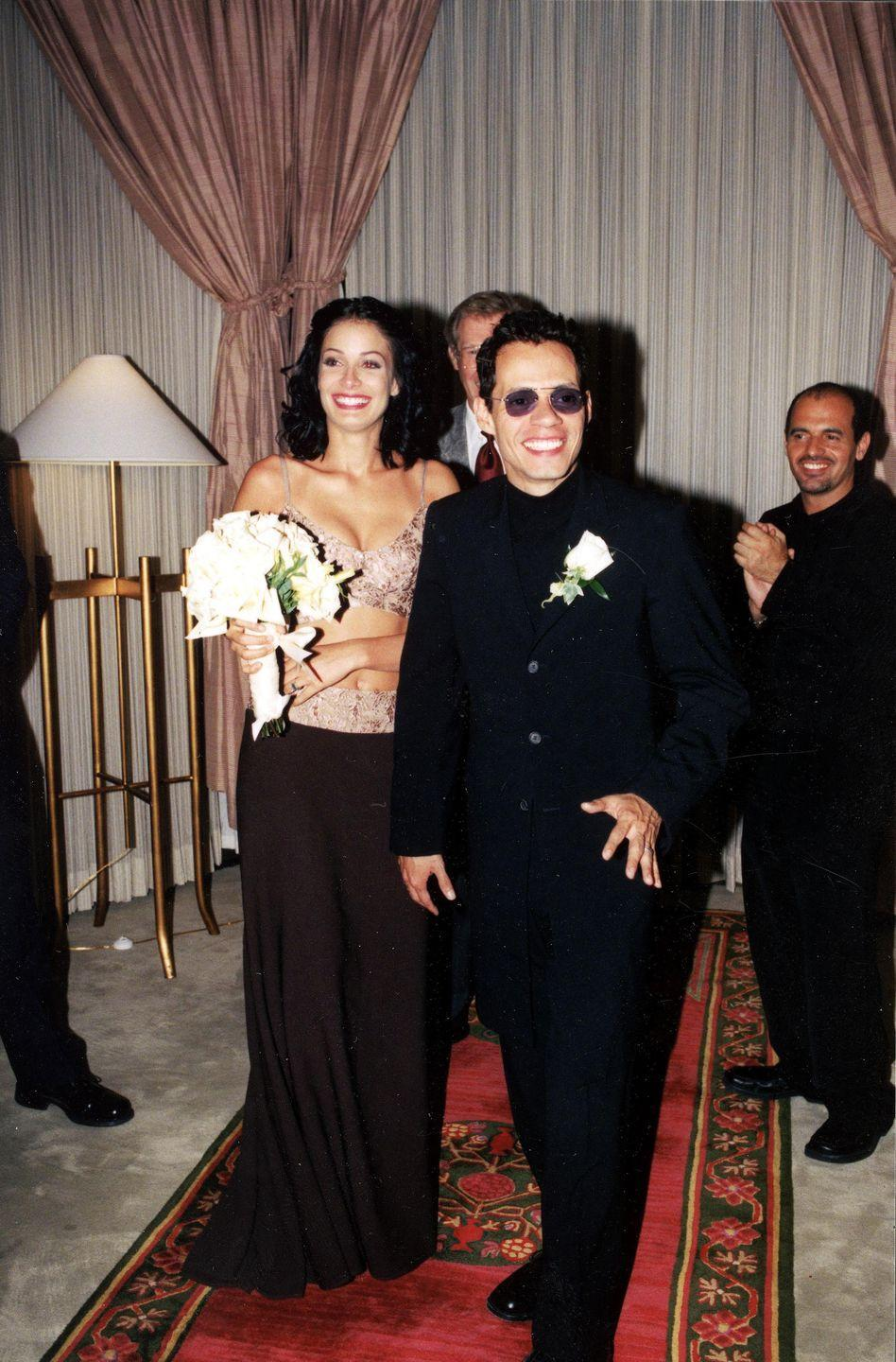 "<p>While the Latin singer and the former Miss Universe first got married in May 2000 at a super-secret Las Vegas ceremony, the vow renewals were a grander affair two years later. The couple and their 200 guests <a href=""https://www.forbes.com/2007/07/12/celebrity-media-weddings-biz-media-cz_lg_ts_0712celebweddings_slide.html#529528202f0b"" rel=""nofollow noopener"" target=""_blank"" data-ylk=""slk:celebrated with a ceremony"" class=""link rapid-noclick-resp"">celebrated with a ceremony</a> in Puerto Rico that reportedly cost $500,000. Anthony and Torres divorced in 2004. </p>"