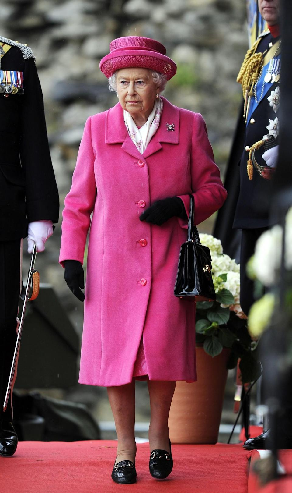 <p>The Queen arrived at Richmond Castle in a cerise pink coat and hat.<br><i>[Photo: PA]</i> </p>