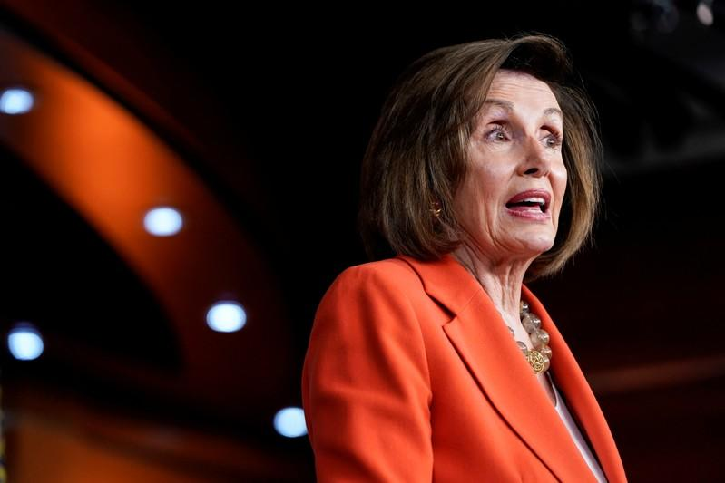 FILE PHOTO: Speaker of the House Nancy Pelosi (D-CA) speaks ahead of a House vote authorizing an impeachment inquiry into U.S. President Trump in Washington