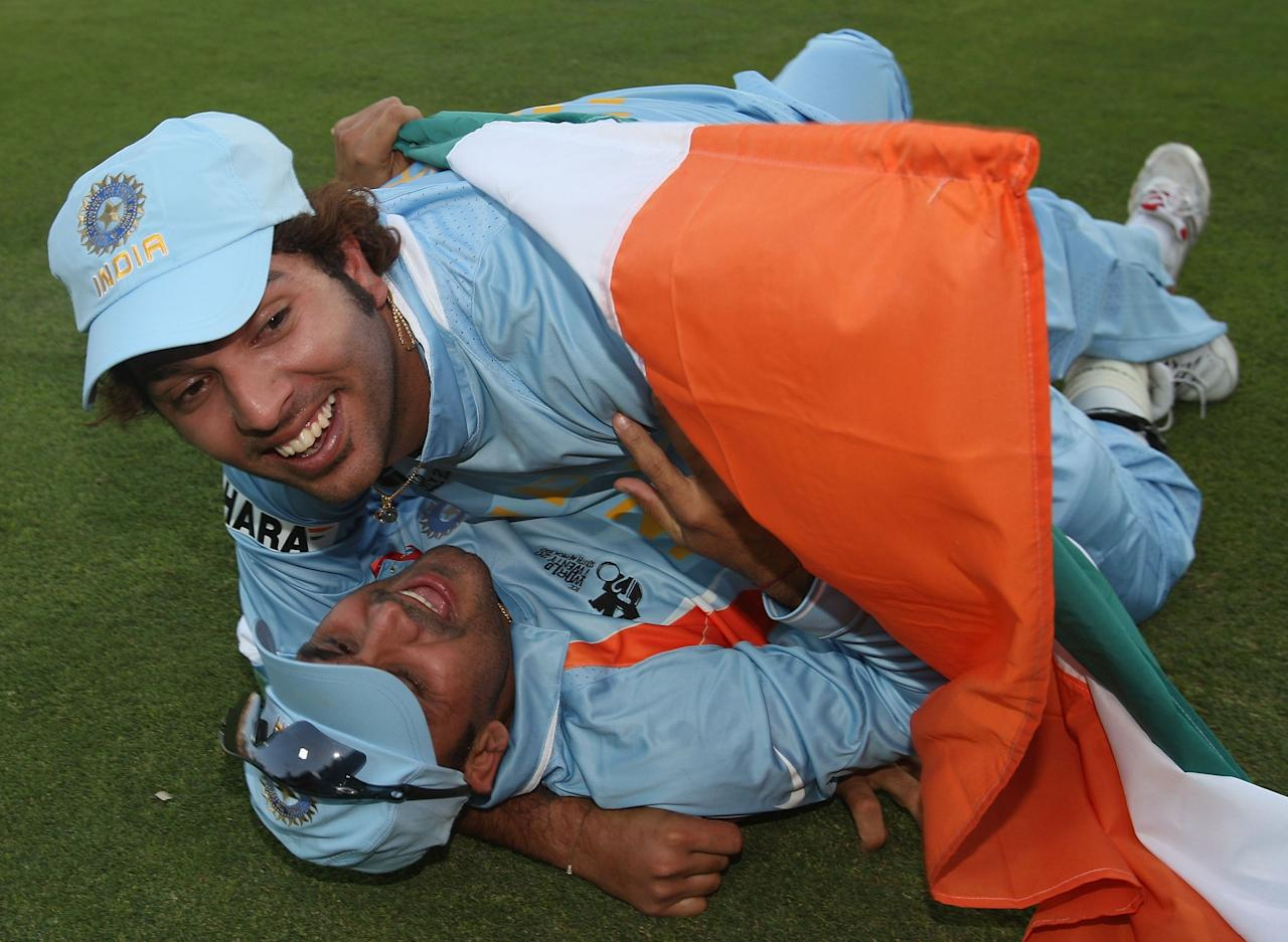 JOHANNESBURG, SOUTH AFRICA - SEPTEMBER 24:  Yuvraj Singh (Top) and Virender Sehwag of India celebrate their win after the Twenty20 Championship Final match between Pakistan and India at The Wanderers Stadium on September 24, 2007 in Johannesburg, South Africa.  (Photo by Hamish Blair/Getty Images)