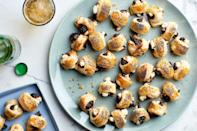 "A vegetarian take on one of our favorite classic appetizer recipes, these honey-glazed figs are baked in puff pastry with creamy, tangy goat cheese and a pinch of red pepper flakes. <a href=""https://www.epicurious.com/recipes/food/views/figs-in-a-blanket-with-goat-cheese?mbid=synd_yahoo_rss"" rel=""nofollow noopener"" target=""_blank"" data-ylk=""slk:See recipe."" class=""link rapid-noclick-resp"">See recipe.</a>"