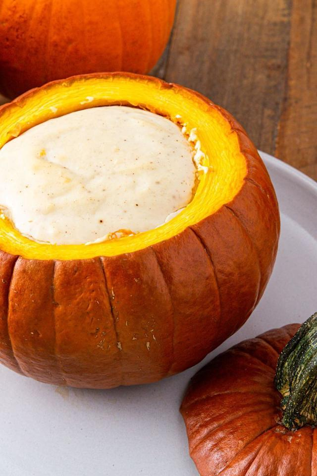"""<p>You could <a href=""""https://www.delish.com/uk/food-news/g33967023/pumpkin-carving-ideas-deisgns/"""" target=""""_blank"""">carve pumpkins</a> this Halloween or you could choose to fill one with cheesecake. For us, it's no question. The pumpkin will bake with the cheesecake leaving the flesh as an edible crust for the cheesecake. We recommend placing a baking pan of water on the lower shelf in the oven to keep the cheesecake from cracking and will help it bake through evenly.</p><p>Get the <a href=""""https://www.delish.com/uk/cooking/recipes/a34039281/cheesecake-stuffed-pumpkin-recipe/"""" target=""""_blank"""">Cheesecake Stuffed Pumpkin</a> recipe.</p>"""