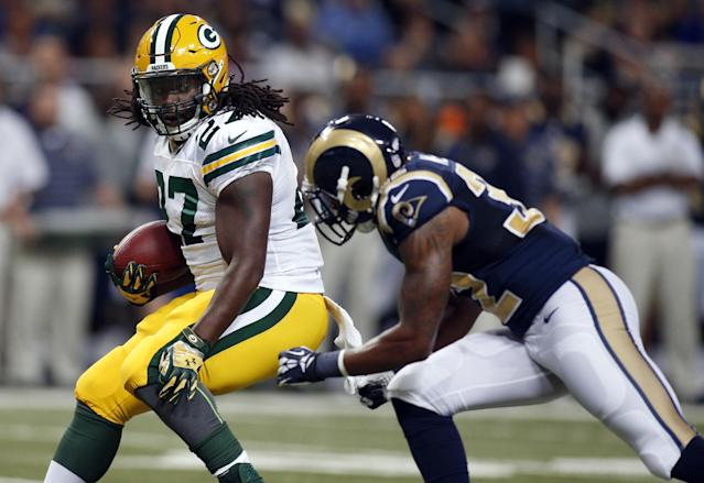 Green Bay Packers running back Eddie Lacy, left, runs with the ball as St. Louis Rams cornerback Brandon McGee defends during the first quarter of an NFL preseason football game Saturday, Aug. 16, 2014, in St. Louis. (AP Photo/Scott Kane)