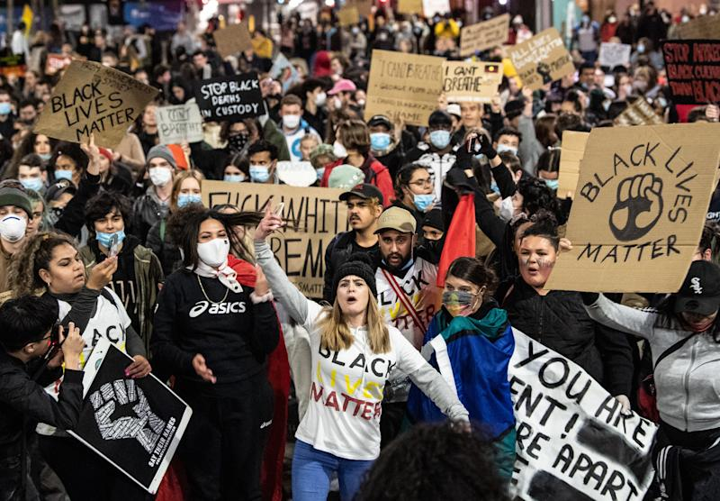 Protesters marching during a Black Lives Matter protest, following the death in Minneapolis police custody of George Floyd, in Sydney, Tuesday, June 2, 2020. (AAP Image/James Gourley) NO ARCHIVING