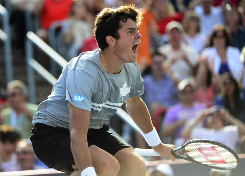 Milos Raonic, of Canada, reacts to defeating fellow Canadian Vasek Pospisil 6-4, 1-6, 7-6 (4) in a semifinal of the Rogers Cup men's tennis tournament in Montreal on Saturday, Aug. 10, 2013. (AP Photo/The Canadian Press, Paul Chiasson)