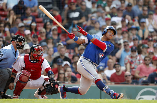 Toronto Blue Jays' Yangervis Solarte watches a hit against the Boston Red Sox during the ninth inning of a baseball game Saturday, July 14, 2018, in Boston. (AP Photo/Winslow Townson)