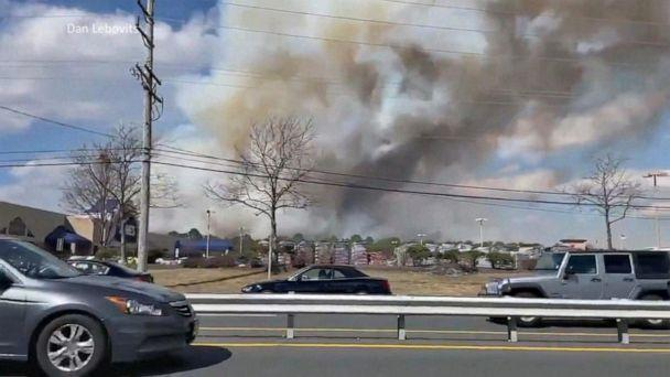 PHOTO: Firefighters in Ocean County, New Jersey work to contain a massive forest fire that burned 170 acres, damaged nearby structures and seriously injured a firefighter on March 14, 2021. (WPVI)