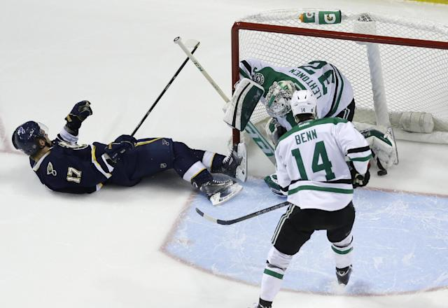St. Louis Blues' Vladimir Sobotka (17), of the Czech Republic, falls as he scores past Dallas Stars goalie Kari Lehtonen, of Finland, and Jamie Benn (14) during the first period of an NHL hockey game Saturday, Nov. 23, 2013, in St. Louis. (AP Photo/Jeff Roberson)