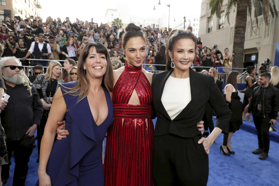 """Director Patty Jenkins, Gal Gadot and Lynda Carter seen at The World Premiere of Warner Bros. Pictures """"Wonder Woman"""". (Photo by Eric Charbonneau/Invision for Warner Bros./AP Images)"""