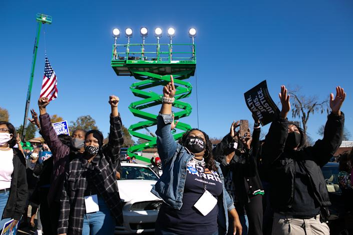 Supporters cheer for Vice President-elect Kamala Harris as she speaks during a drive-in rally in Columbus, Georgia. (Photo by Jessica McGowan/Getty Images)