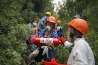 Turkish volunteers head to fight wildfires in Turgut village, near tourist resort of Marmaris, Mugla, Turkey, Wednesday, Aug. 4, 2021. As Turkish fire crews pressed ahead Tuesday with their weeklong battle against blazes tearing through forests and villages on the country's southern coast, President Recep Tayyip Erdogan's government faced increased criticism over its apparent poor response and inadequate preparedness for large-scale wildfires.(AP Photo/Emre Tazegul)