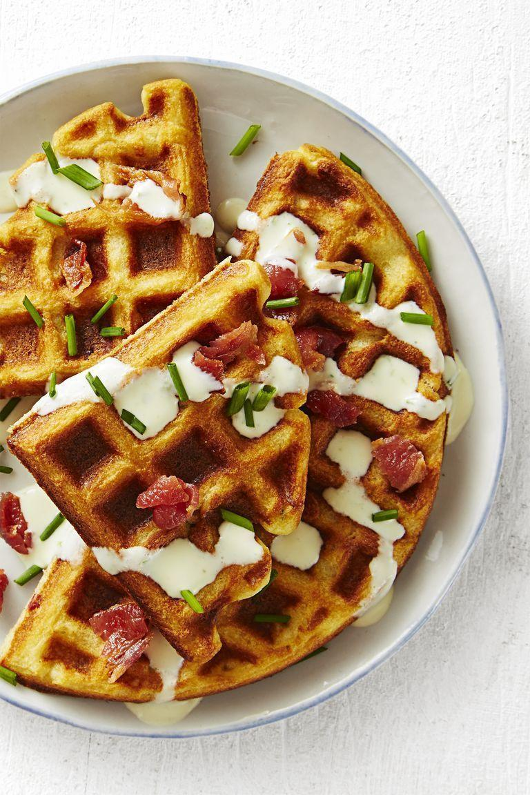 "<p>If you usually cover your waffles in powdered sugar and maple syrup, you're missing out — savory waffles with bacon and (believe it or not) ranch dressing makes and amazing breakfast.<br></p><p><em><a href=""https://www.goodhousekeeping.com/food-recipes/a45223/savory-bacon-chive-waffles-recipe/"" rel=""nofollow noopener"" target=""_blank"" data-ylk=""slk:Get the recipe for Savory Bacon Chive Waffle »"" class=""link rapid-noclick-resp"">Get the recipe for Savory Bacon Chive Waffle »</a></em></p>"