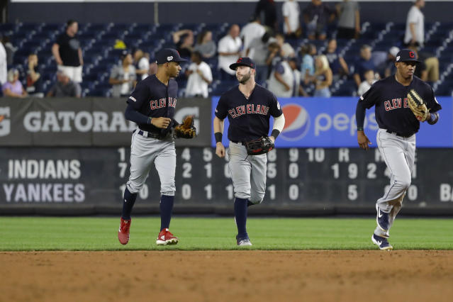 Cleveland Indians' Tyler Naquin, center, Oscar Mercado, left, and Greg Allen run off the field after the team's baseball game against the New York Yankees Thursday, Aug. 15, 2019, in New York. The Indians won 19-5. (AP Photo/Frank Franklin II)