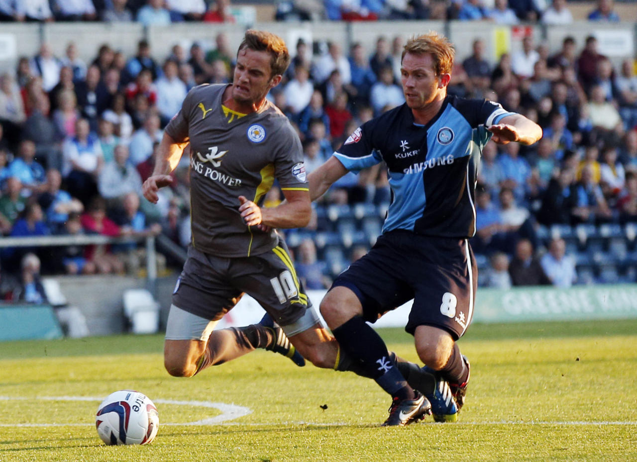Leicester City's Andy King (left) is felled by Wycombe's Stuart Lewis (right) resulting in a penalty during the Capital One Cup, First Round match at Adams Park, Wycombe.