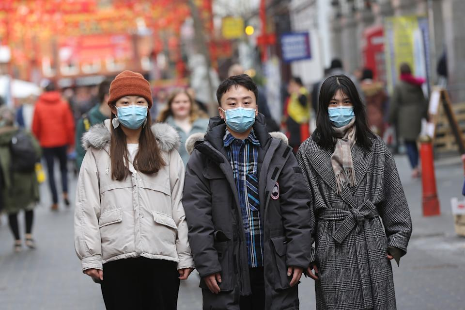 LONDON, UNITED KINGDOM - MARCH 07: People wear medical masks as a precaution against coronavirus in central London, England on March 07, 2020. The number of coronavirus cases in the UK has reached 206 today. (Photo by Ilyas Tayfun Salci/Anadolu Agency via Getty Images)